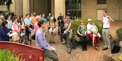 Walking tour gathering with many people at the foot of UW Tower